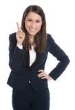 Den lyckliga affärskvinnan pekar med pekfingret som isoleras på whi Royaltyfri Fotografi