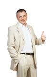 Den lyckliga affärsmannen med tummar gör en gest upp Arkivbilder