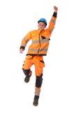 Den lyckliga byggmästaren, i att fungera, beklär att lyfta upp handen Arkivbild