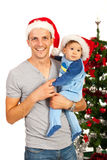 Den lyckliga fadern med behandla som ett barn på jul Arkivfoton