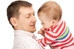Den lyckliga fadern med förtjusande behandla som ett barn Arkivbild