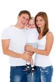 Den lyckliga familjen med behandla som ett barn. Royaltyfria Foton