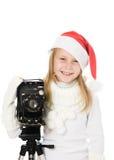 Den lyckliga flickan i jul kostymerar med den gammala kameran Royaltyfri Bild