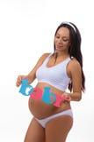 Den lyckliga gravida mamman som väntar på, kopplar samman, flickan och pojken royaltyfri foto