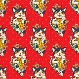 Den lyckliga japanska katten Maneki-neko blommade Arkivfoto