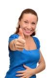 Den lyckliga kvinnan tycker om framgång Arkivfoto