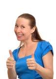 Den lyckliga kvinnan tycker om framgång Fotografering för Bildbyråer