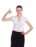 Den lyckliga le affärskvinnan som visar tum, up ges Arkivbilder