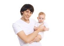 Den lyckliga le fadern och behandla som ett barn på vit bakgrund Royaltyfri Fotografi