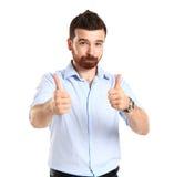 Den lyckliga le unga affärsmanen med tum göra en gest upp Royaltyfria Bilder