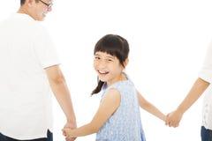 Den lyckliga liten flickahållen uppfostrar händer och att le arkivfoto