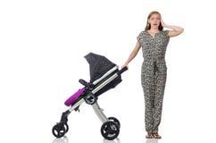 Den lyckliga mamman med henne behandla som ett barn i pram Fotografering för Bildbyråer