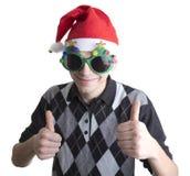 Den lyckliga mannen i jul party exponeringsglas Royaltyfri Foto