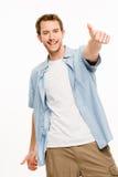 Den lyckliga mannen tummar upp vit bakgrund Arkivfoton