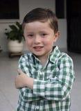 Den lyckliga pojken tycker om Royaltyfria Bilder