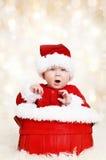 Den lyckliga Santa julen behandla som ett barn Arkivbilder