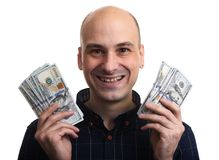 Den lyckliga skalliga mannen rymmer några pengar isolerat arkivbilder
