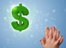 Den lyckliga smileyen fingrar se det gröna bladdollartecknet Royaltyfri Foto