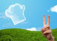 Den lyckliga smileyframsidan fingrar se illustrationen av kockhatten Arkivfoton