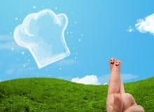 Den lyckliga smileyframsidan fingrar se illustrationen av kockhatten Royaltyfria Bilder