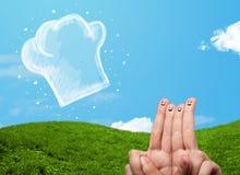 Den lyckliga smileyframsidan fingrar se illustrationen av kockhatten Arkivbild