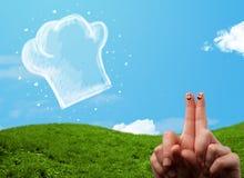 Den lyckliga smileyframsidan fingrar se illustrationen av kockhatten Fotografering för Bildbyråer