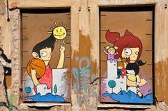 Den lyckliga tecknade filmen figurerar grafitti Royaltyfri Fotografi