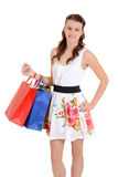 Den lyckliga teen flickan med shopping hänger lös Arkivfoto
