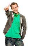 Den lyckliga unga caucasian mannen som ger tummar, up teckenvitbakgrund Royaltyfria Bilder