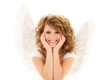 Den lyckliga unga kvinnan eller den tonåriga flickan med ängel påskyndar arkivfoto