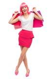 Den lyckliga unga kvinnan med shopping hänger lös Royaltyfria Foton