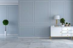 Den lyxiga moderna ruminredesignen, tömmer rum, den vita serveringsbordet med lampan och växten på ljus - det gråa vägg- och marm Royaltyfria Bilder