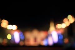 Den mångfärgade staden tänder suddig bokehbakgrund Royaltyfria Foton