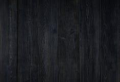 den mörka texturen av träbräden Royaltyfria Bilder