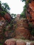 Den 71m högväxta jätte- Buddha (Dafo) som in snidas ut ur berget Fotografering för Bildbyråer