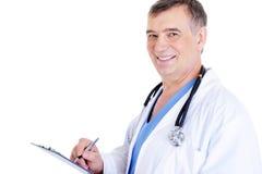 den male doktorn mature något writing royaltyfri fotografi