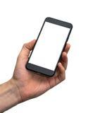 Den manliga handen som rymmer ett svart, ilar telefonen arkivfoton