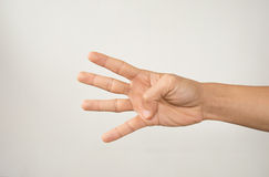 Den manliga handen visar fyra isolerade fingrar Royaltyfria Bilder