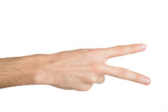 Den manliga handen visar nummer två som isoleras på vit Royaltyfri Foto