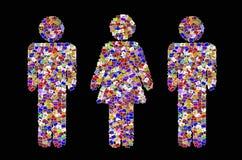Den manliga och kvinnliga symbolen skapar från många bilden Arkivfoton