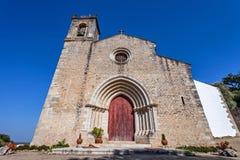Den medeltida kyrkan av Santa Cruz med en gotisk portal Royaltyfria Bilder