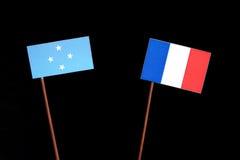 Den Micronesian flaggan med franska sjunker isolerat på svart royaltyfri fotografi