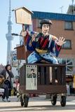 Den mobila statyn av en japansk bonde Arkivfoto