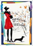 Den moderna kvinnan går ner gatan, höst Arkivbild