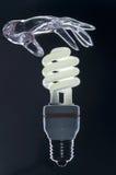 den moderna lampan gömma i handflatan genomskinligt Royaltyfri Bild