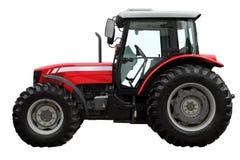 Den moderna röda traktoren Arkivfoto