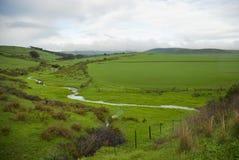 den molniga dagen fields green Arkivfoto