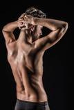 Den muskulösa unga sexiga nakna gulliga mannen Arkivbilder