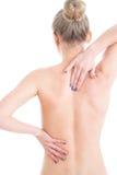 Den näcka kvinnan med smärtar i henne tillbaka Isolerat på vit royaltyfri foto