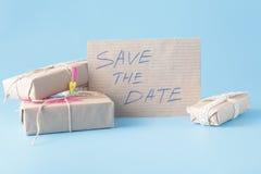 Den närvarande asken och meddelandet sparar datumet Fotografering för Bildbyråer